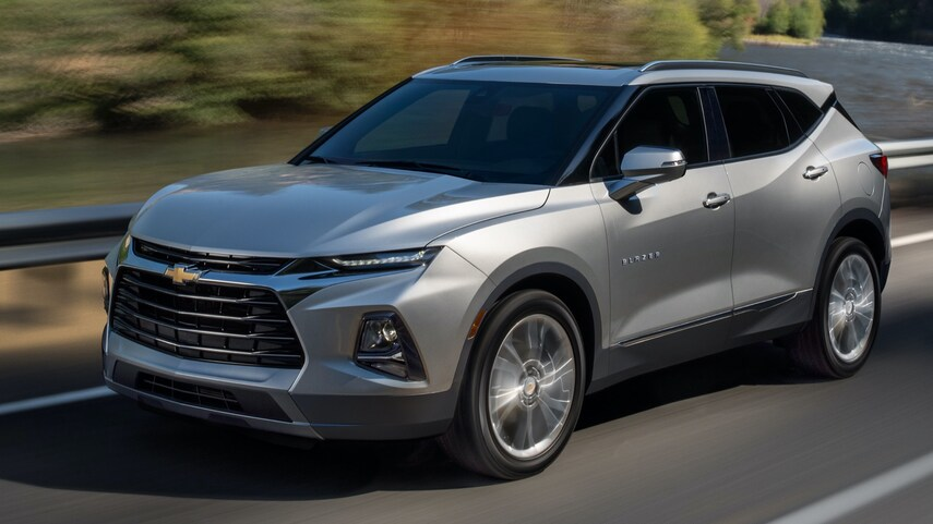 A silver 2022 Chevy blazer driving down the road