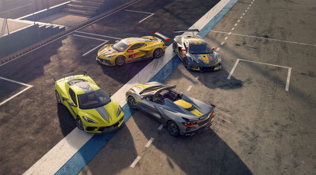 An overhead view of a yellow 2022 Chevrolet Corvette IMSA GTLM Championship Edition Coupe and gray Convertible in front of the yellow No. 3 and gray No.4 Corvette C8.R race cars on a racetrack
