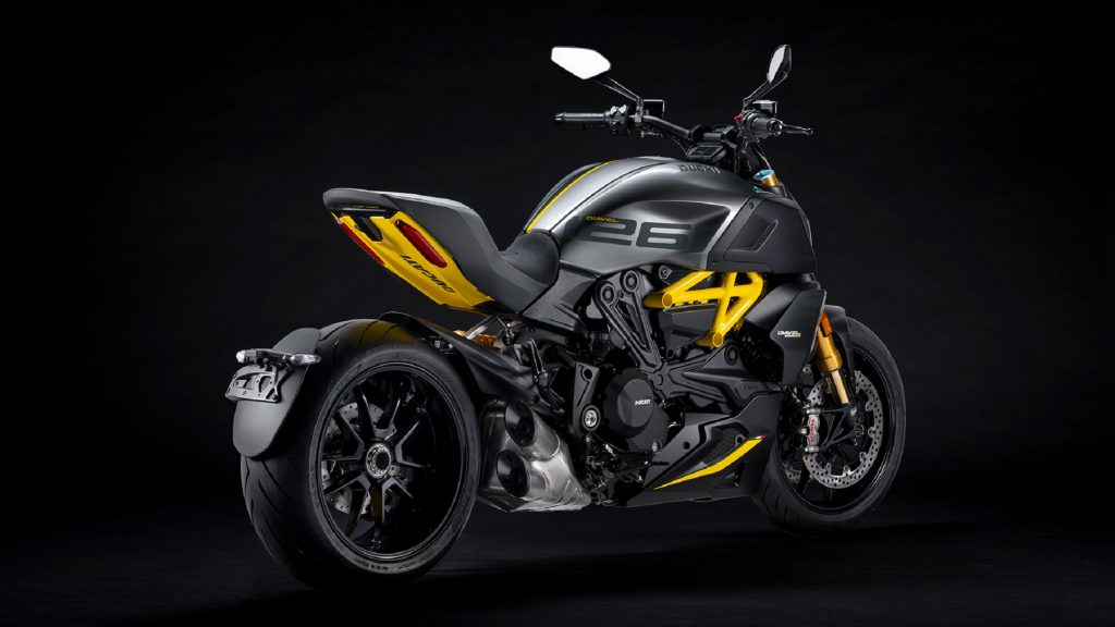 The rear 3/4 view of a yellow-and-matte-gray-and-black 2022 Ducati Diavel 1260 S Black and Steel