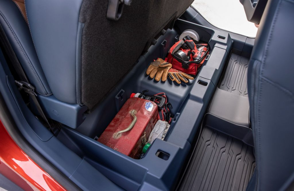 Various items in the underseat storage bins of a 2022 Ford Maverick EcoBoost Lariat