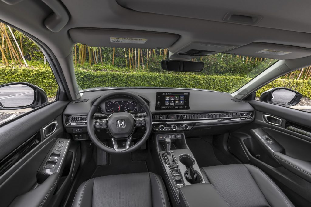 The black front seats and dashboard of a 2022 Honda Civic Sedan Touring