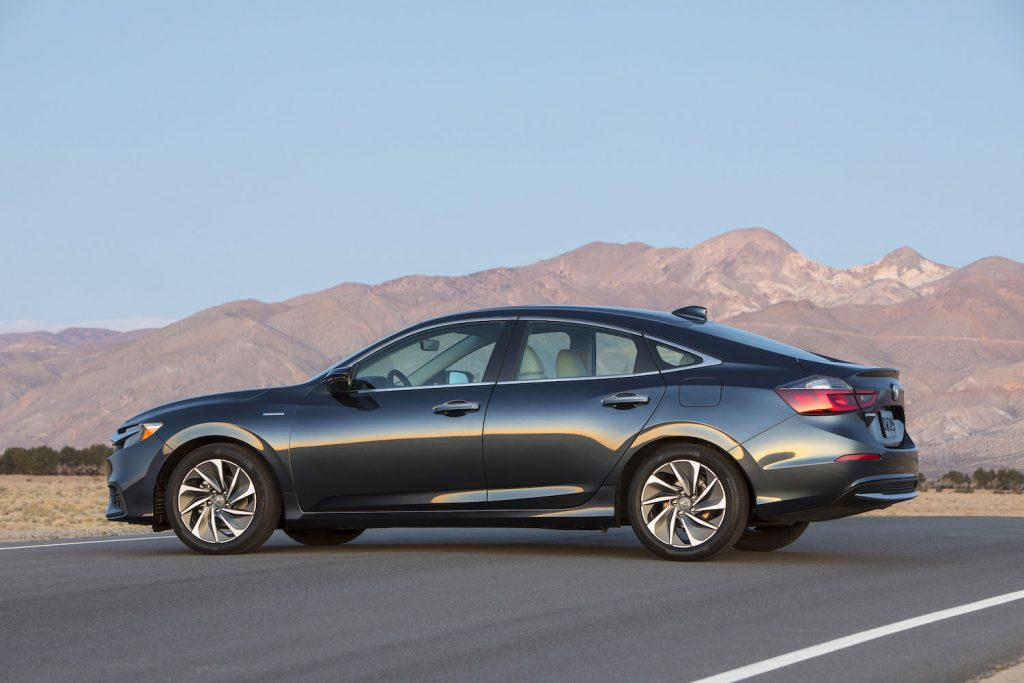 A black 2022 Honda Insight parked in front of a mountain range, the Insight is one of the best new cars under $40,000