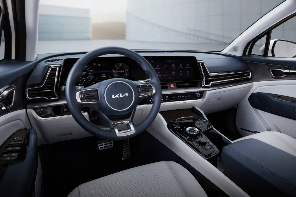 The blue and beige interior of the 2023 Kia Sportage