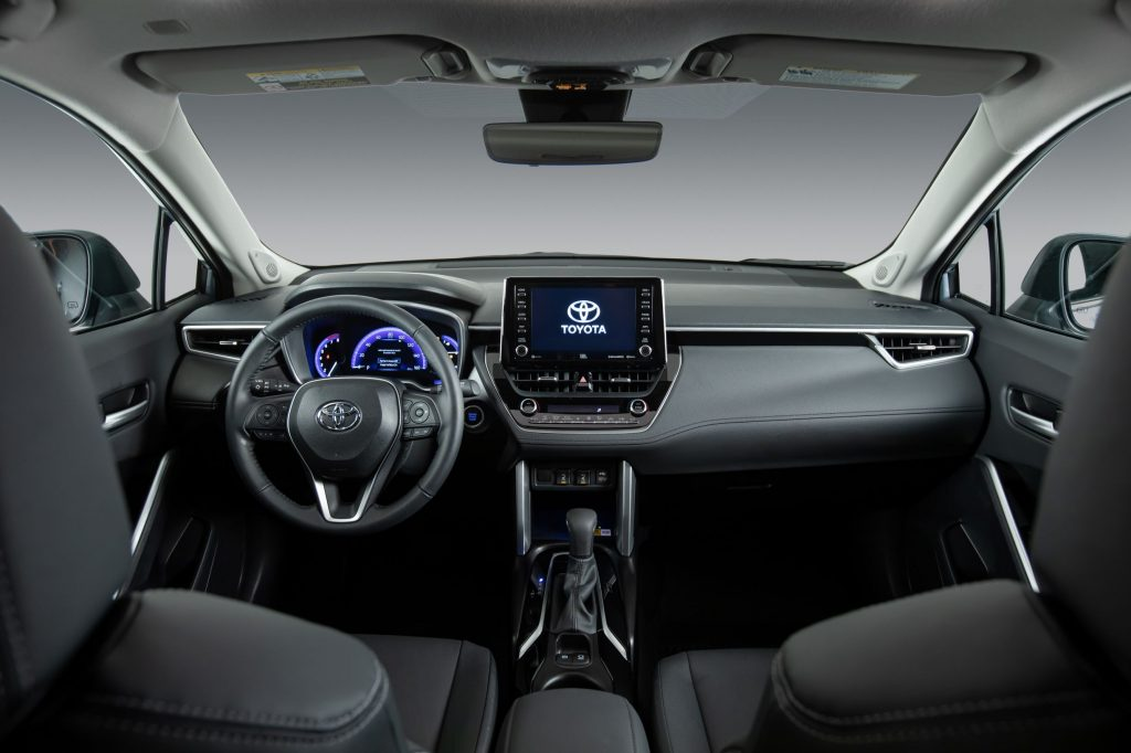 The gray front seats and dashboard of a 2022 Toyota Corolla Cross XLE AWD