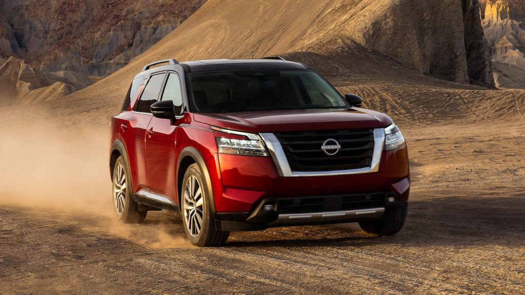 A red 2022 Nissan Pathfinder on dirt road