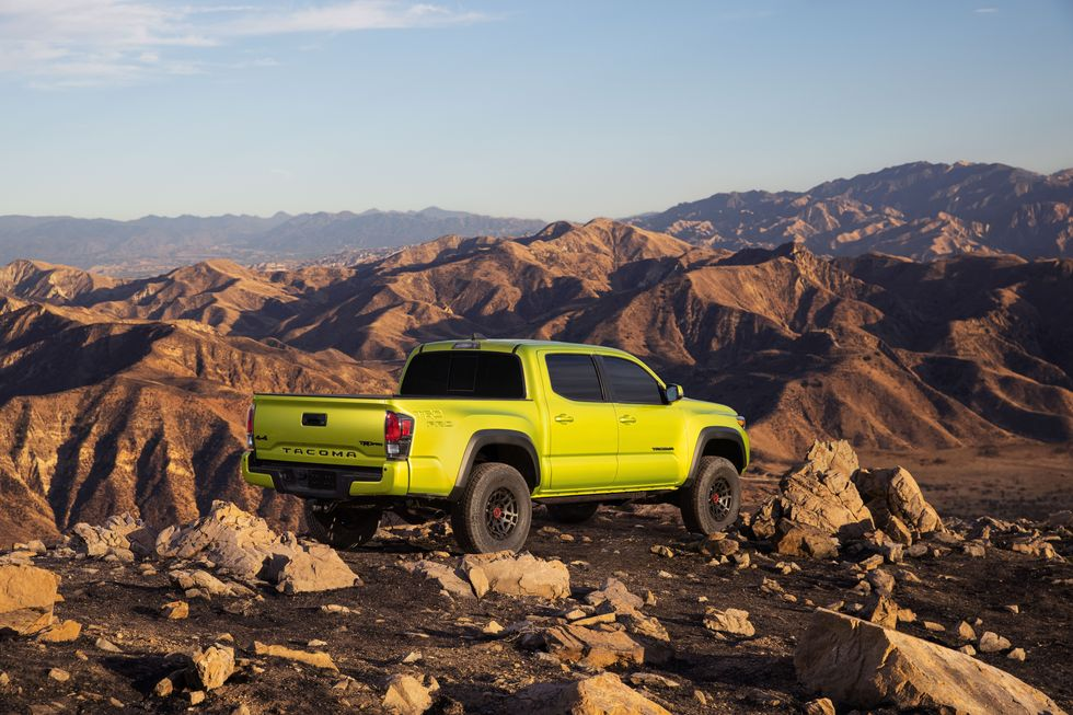 The 2022 Toyota Tacoma TRD Pro in Electric Lime parked on rocks