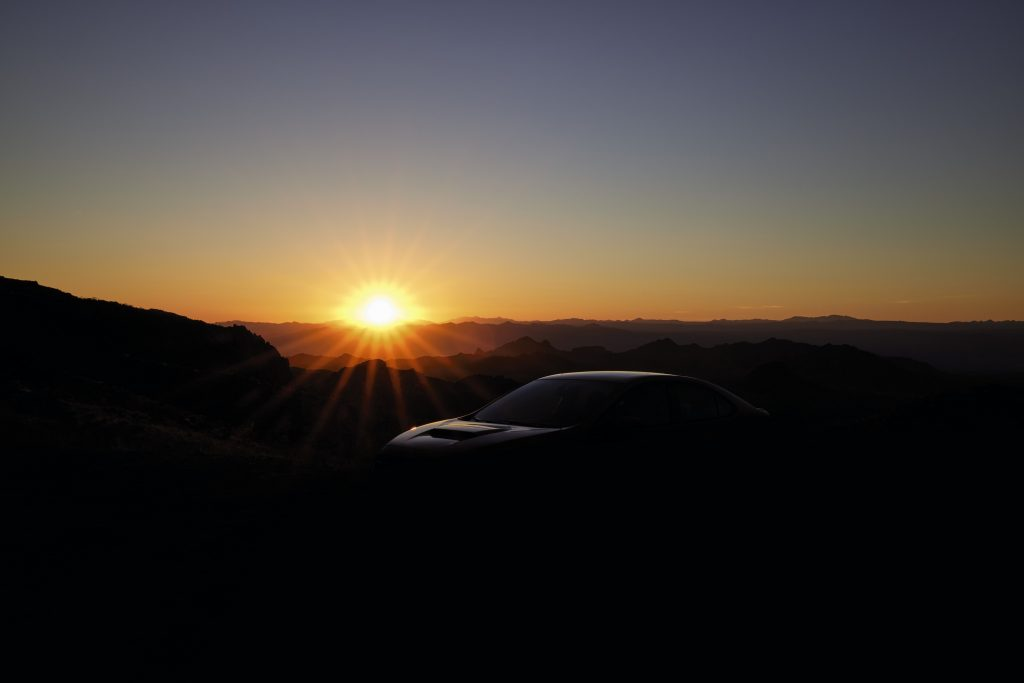 The new 2022 Subaru WRX silhouetted by the sunset