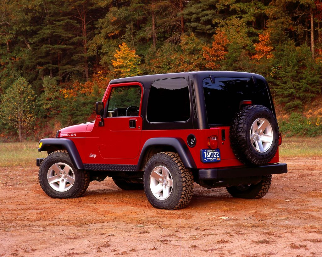 The rear of a red TJ Wrangler photographed at sunset