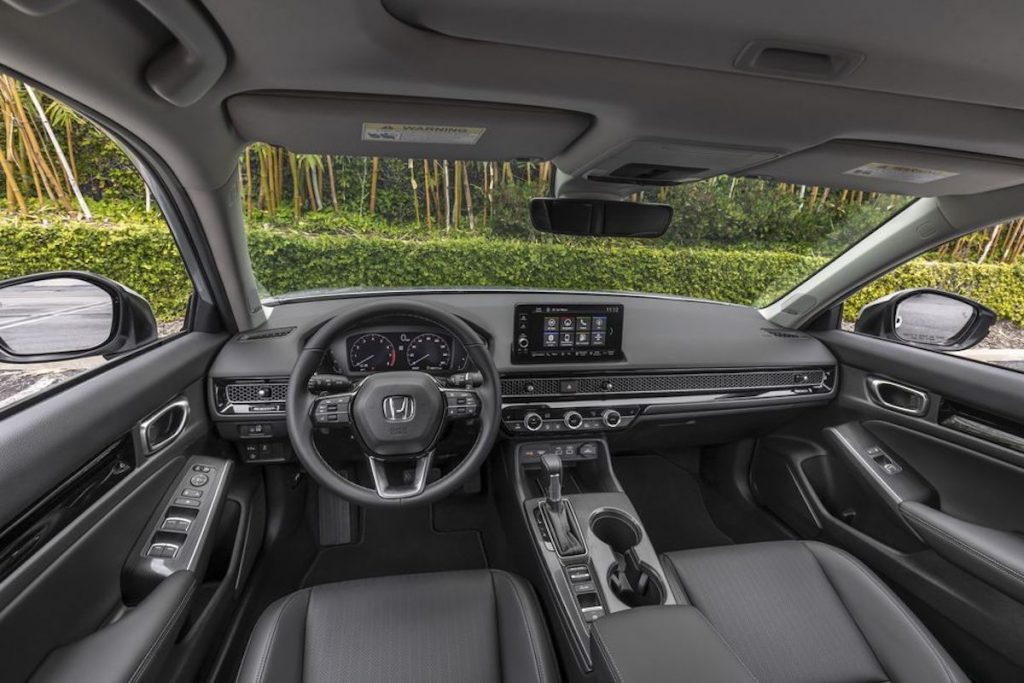 the 2022 Honda Civic interior. Front seats, steering wheel, and dash