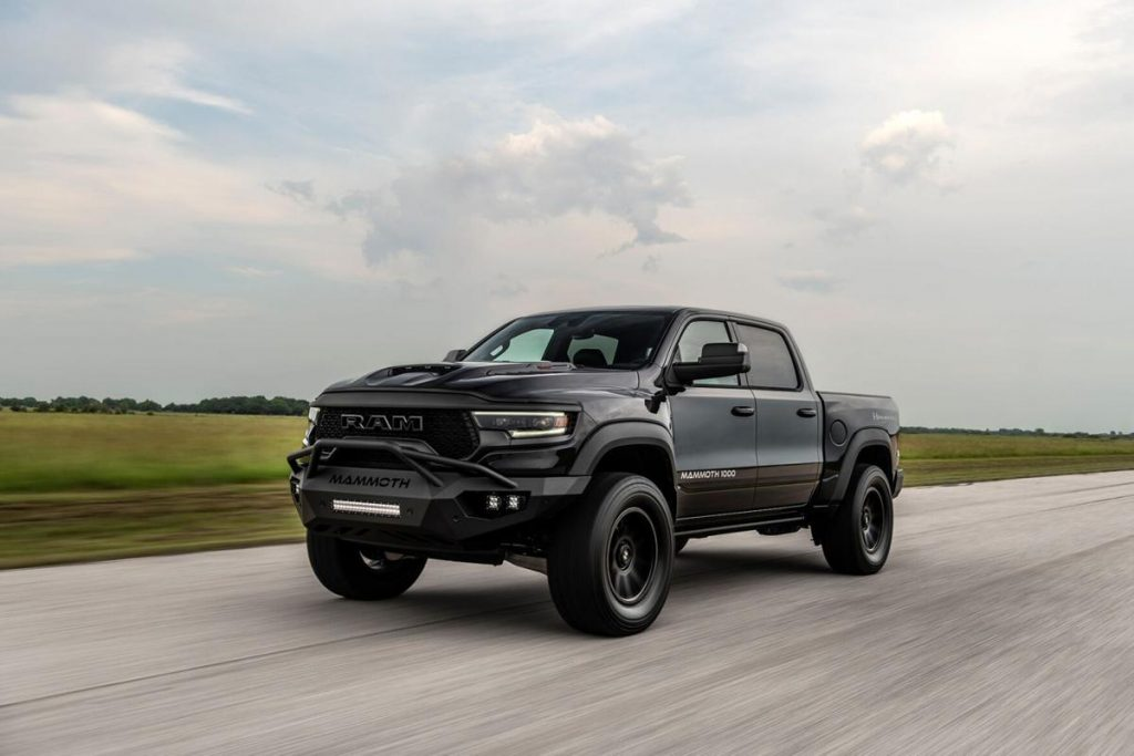 A black Hennessey Mammoth 1000 TRX racing down the road