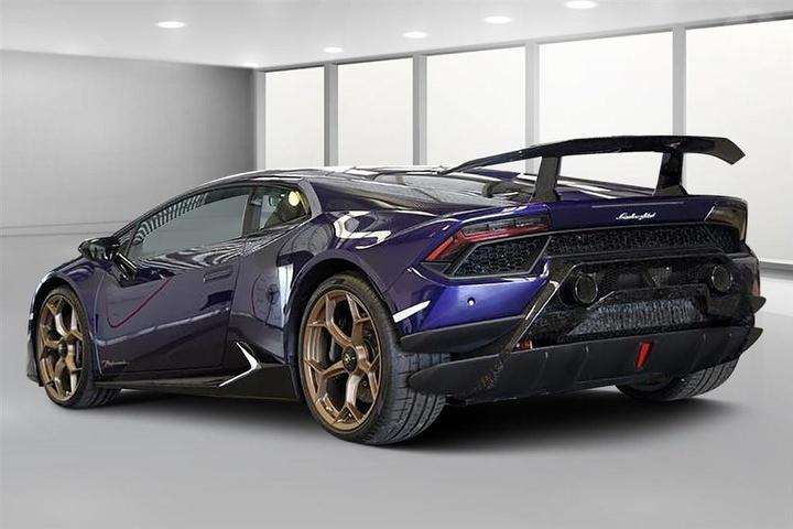 An image of a purple Lamborghini Huracan Performante held for auction.