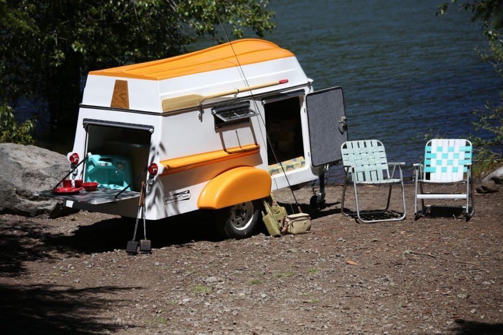 American Dream Travel Trailer camping near a lakeshore