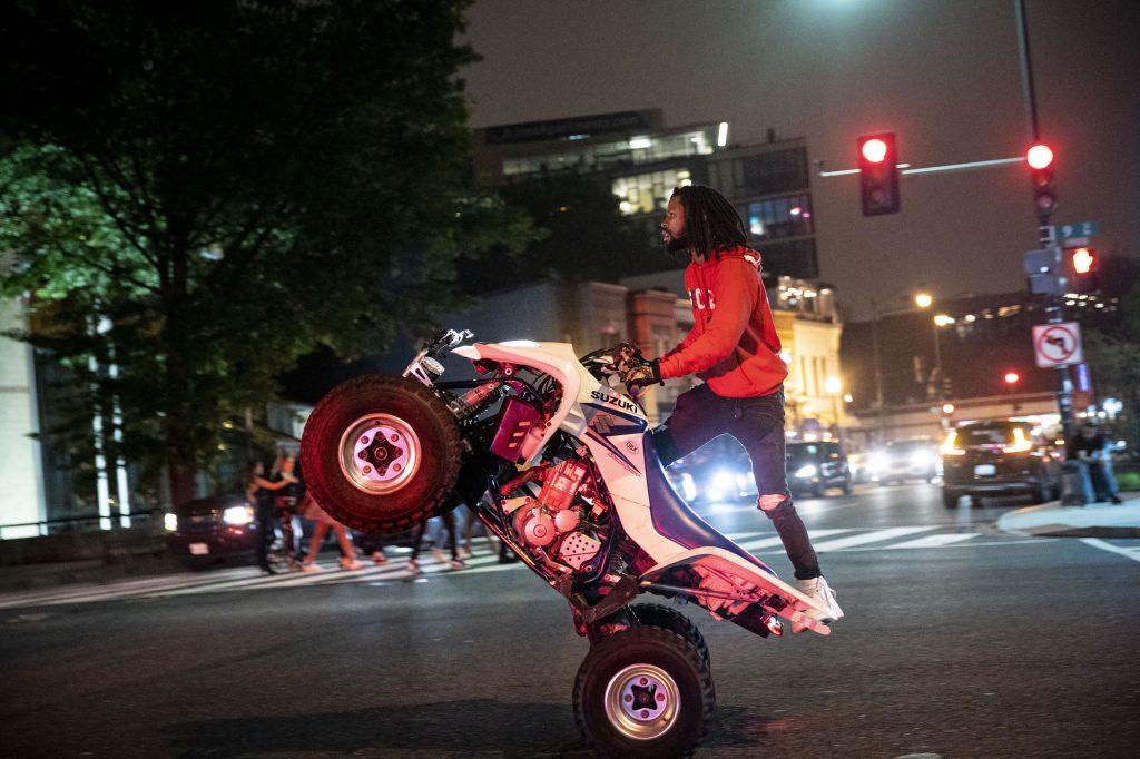 A man rides an ATV on U Street in Washington, D.C., the night of June 11, 2021