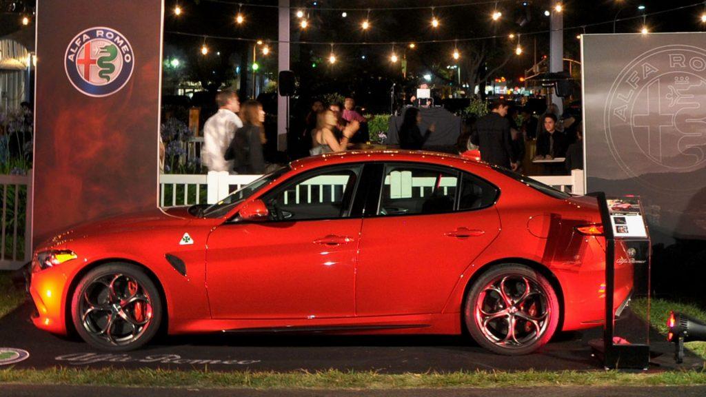 A red Alfa Romeo Giulia Quadrifolgio.