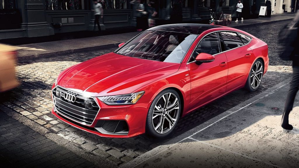 A red Audi A7 parked in a city.