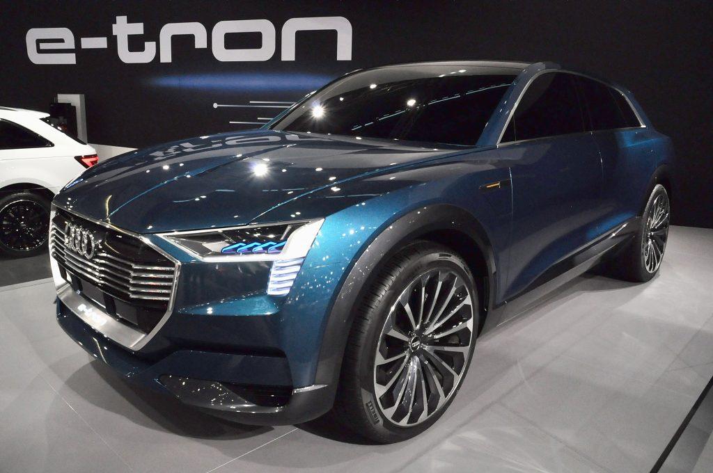 A blue Audi E=Tron EV on display