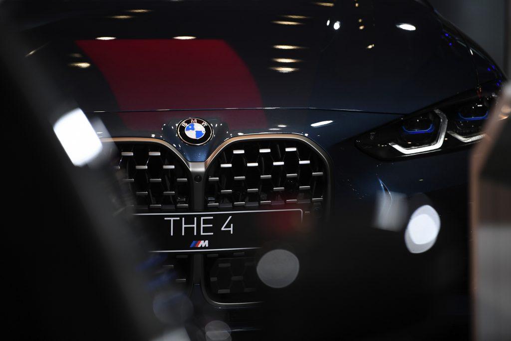 A black BMW 4 Series luxury automobile in the BMW Welt showroom, operated by Bayerische Motoren Werke AG, in Munich, Germany