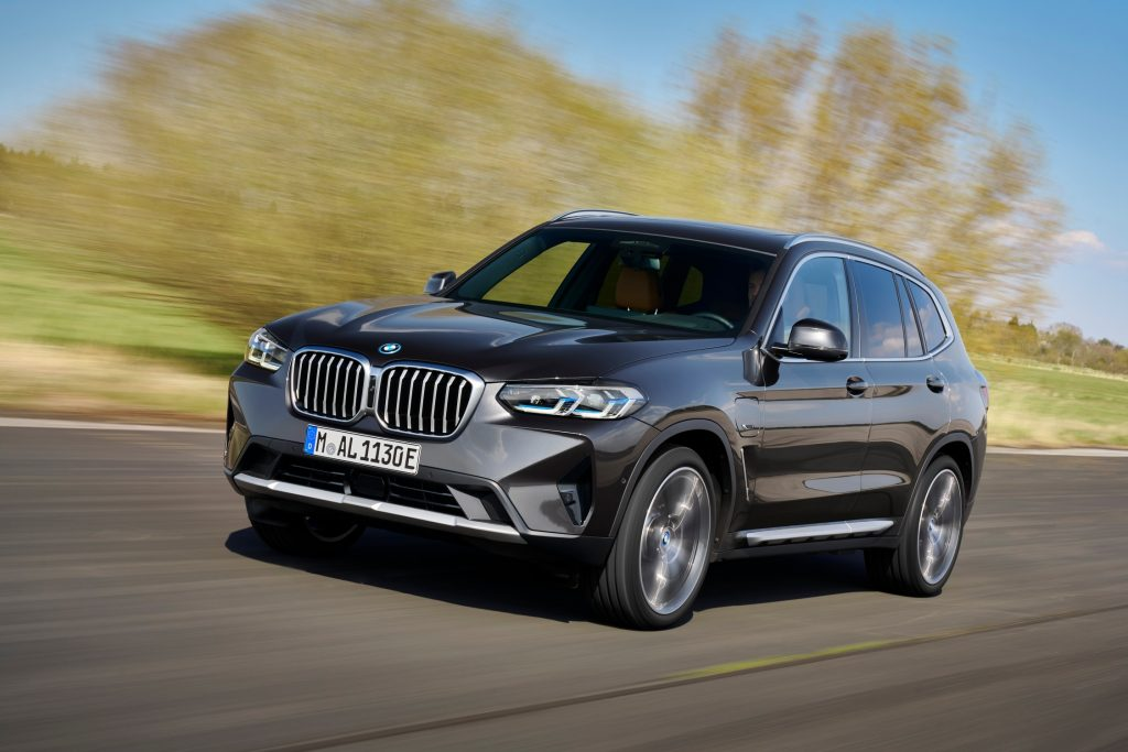 The 2021 BMW X3 driving down a country road