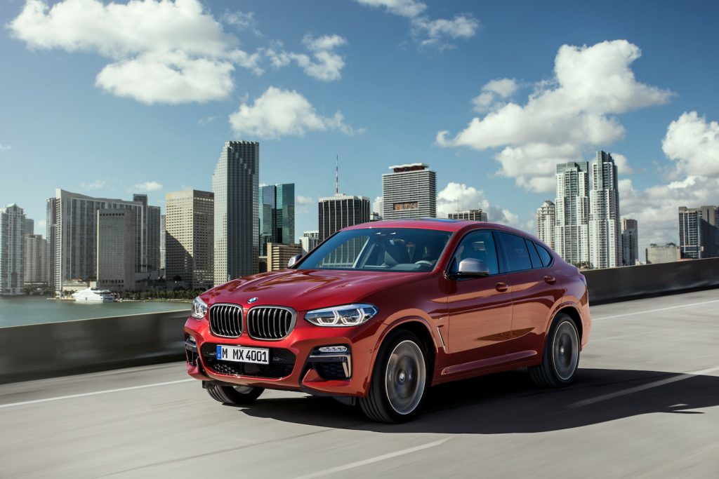 A red BMW X4 driving, the X4 is one of the fastest new SUVs under $50,000