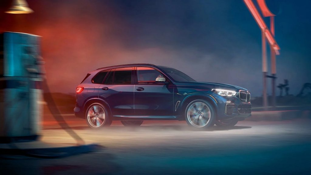 The side profile of a blue 2021 BMW X5.