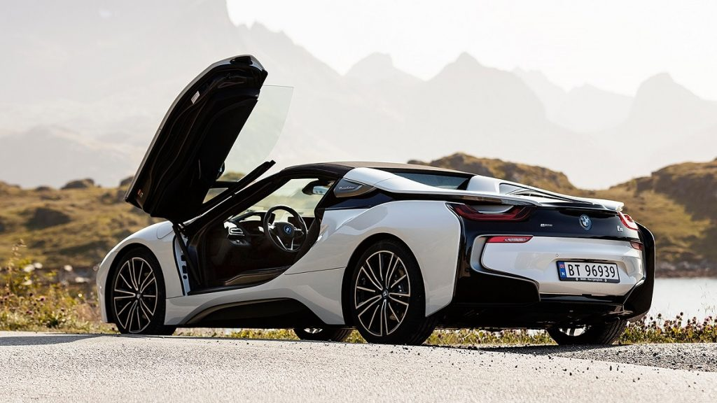 A white BMW i8 with its door opened.