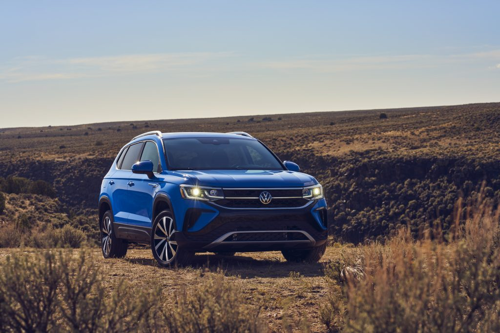 The blue 2022 Volkswagen Taos parked in the desert