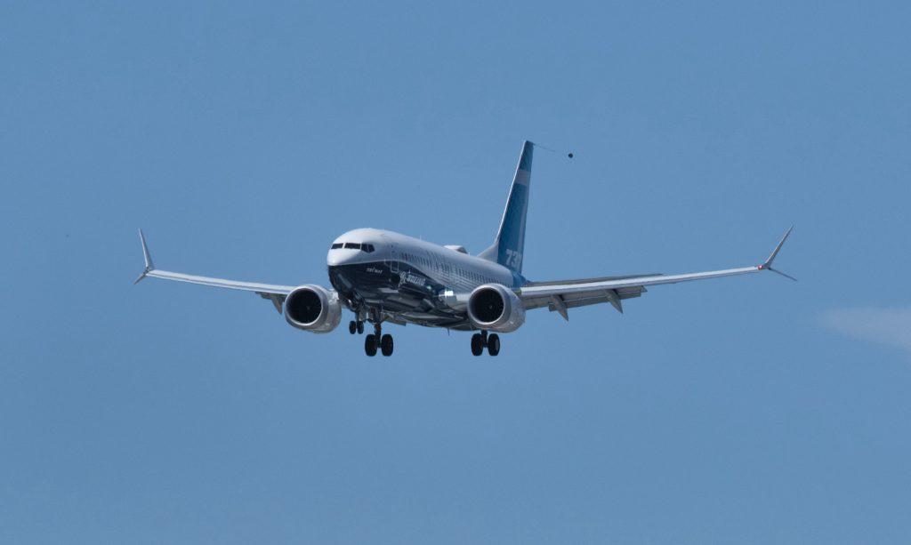 A Boeing 737 MAX airplane lands following an FAA recertification flight at Boeing Field in Seattle in June 2020