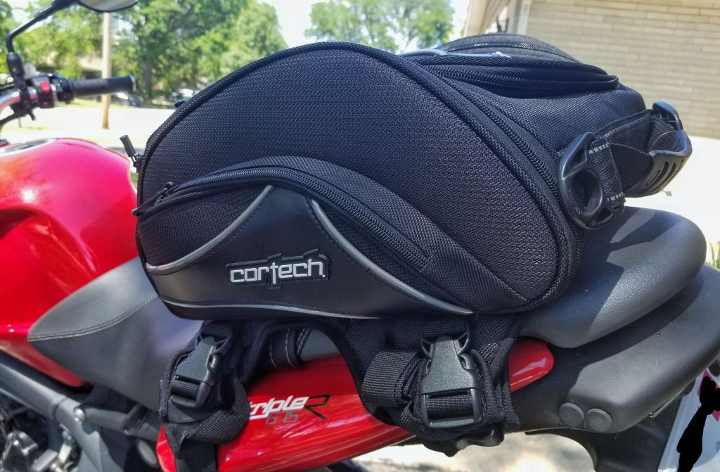 A black Cortech Super 2.0 Tail Bag on a red 2012 Triumph Street Triple R