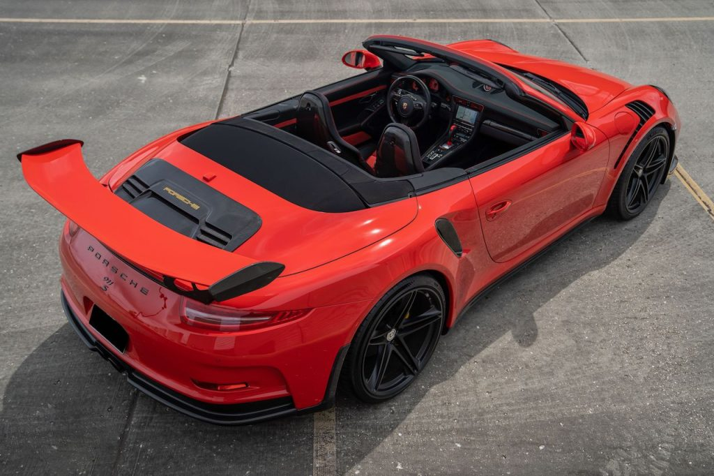 An image of a Porsche 911 GT3 RS Convertible build parked outdoors.