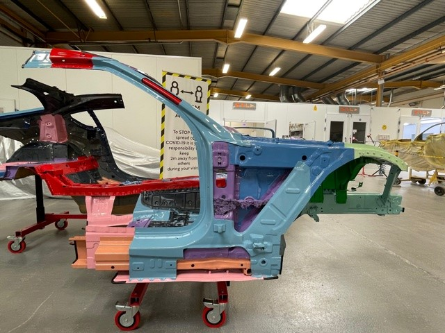 An image of the frame out of a Toyota Supra in a workshop.