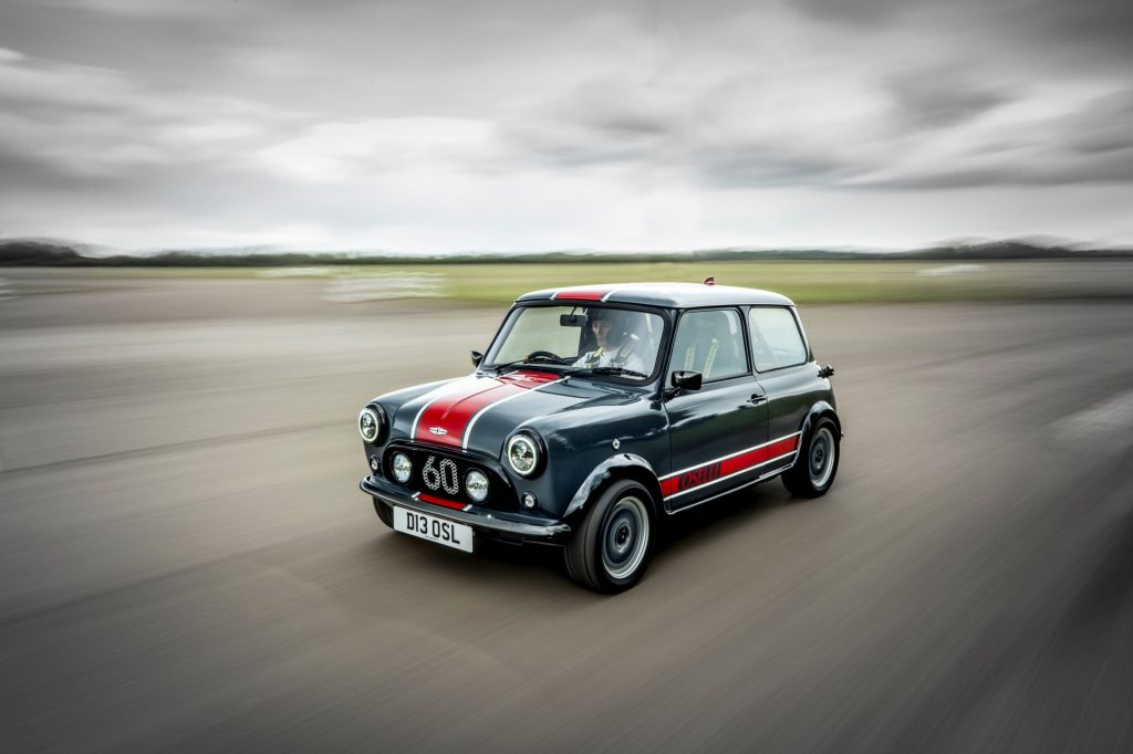 A gray-and-red David Brown Automotive Mini Remastered Oselli Edition goes around a track
