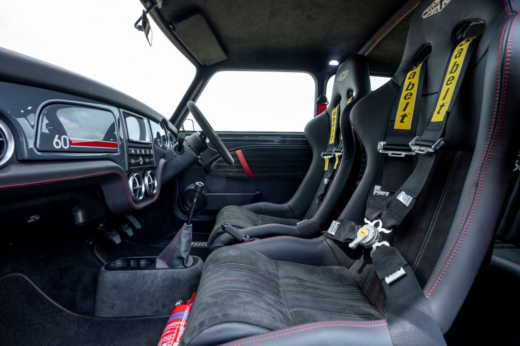 A side view of the Sabelt front seats and gray dashboard of a David Brown Automotive Mini Remastered Oselli Edition