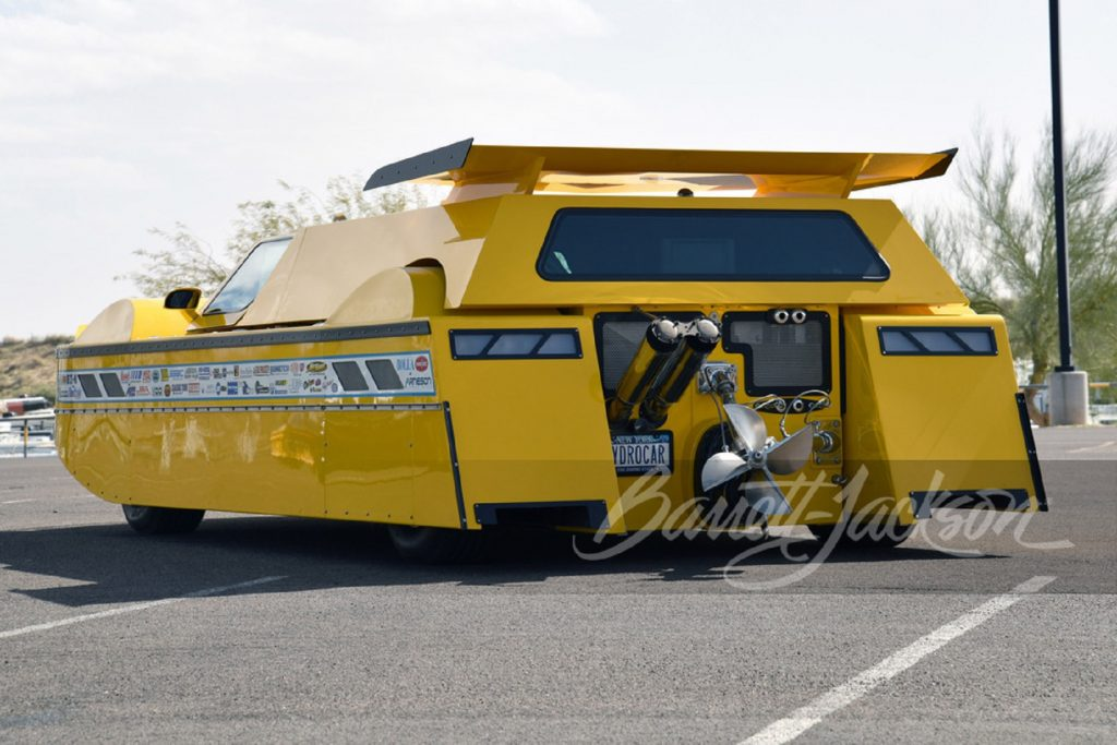 The rear 3/4 view of the yellow Dobbertin Hydrocar in a parking lot