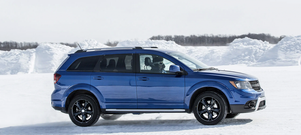 A blue Dodge Journey SUV in the snow