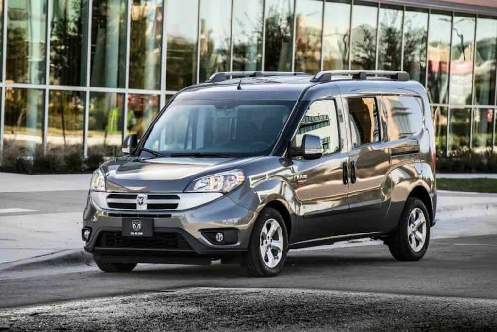 the Dodge Promaster pictured is a tiny van perfect for a camper van conversion