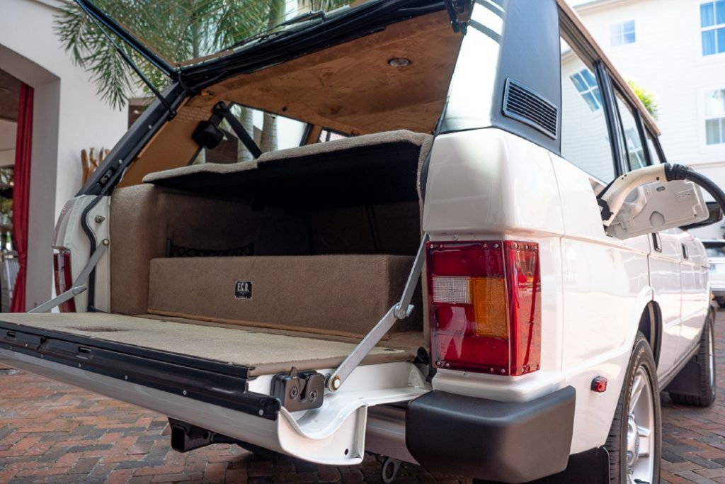 The rear view and cargo area of the white ECD electric Range Rover Classic