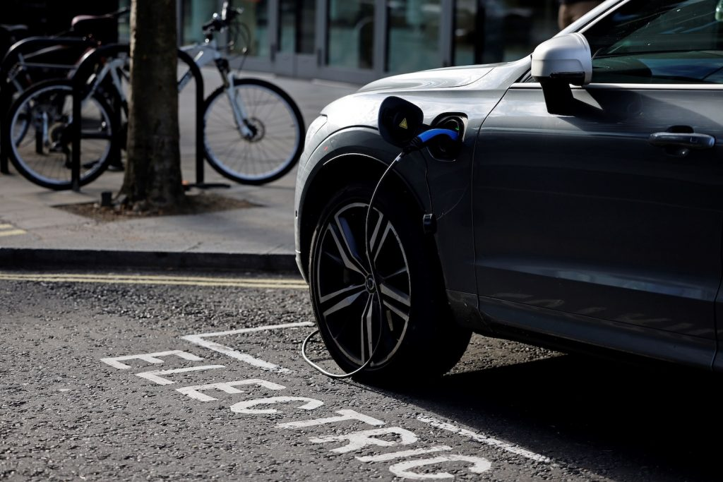 A charging cable is pictured plugged into a Volvo electric vehicle (EV), parked in a parking bay reserved for electric vehicles, in London. Good charging habits can help EV owners overcome EV range anxiety.