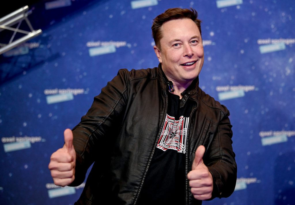 Tesla CEO Elon Musk making a double thumbs up gesture
