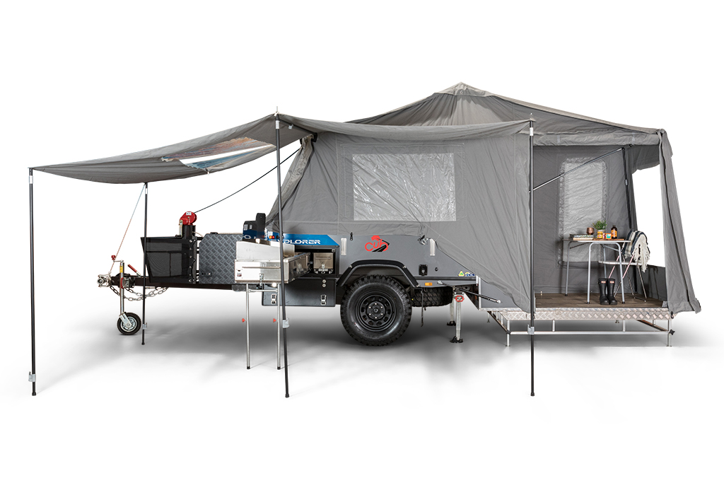 the cub explorer camper trailer set up for a press photo with the tent erected against a white backdrop