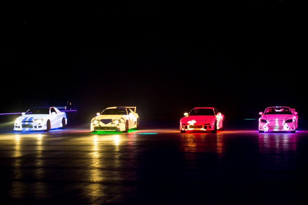 Four cars prepare for a Fast & Furious Live performance