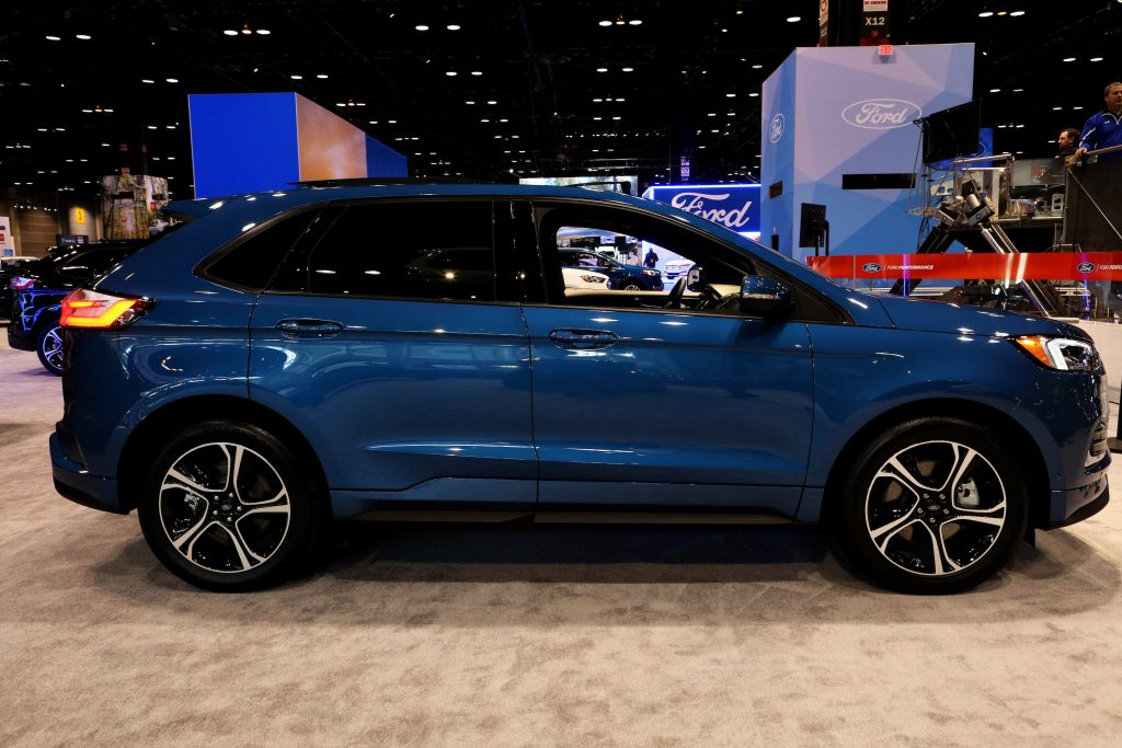 A blue Ford Edge crossover on display