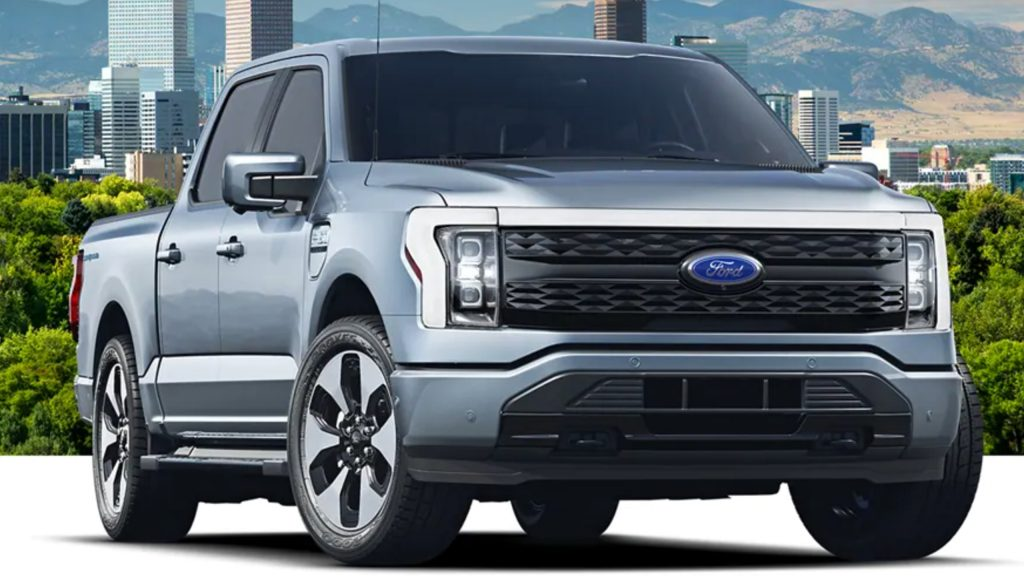 The 2022 Ford F-150 Lightning parked in front of buildings