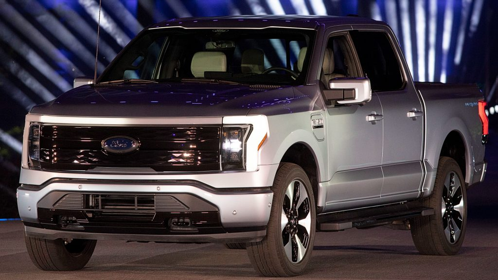 Silver new all-electric Ford F-150 Lightning performance pickup truck is revealed at a livestream event at Ford World Headquarters