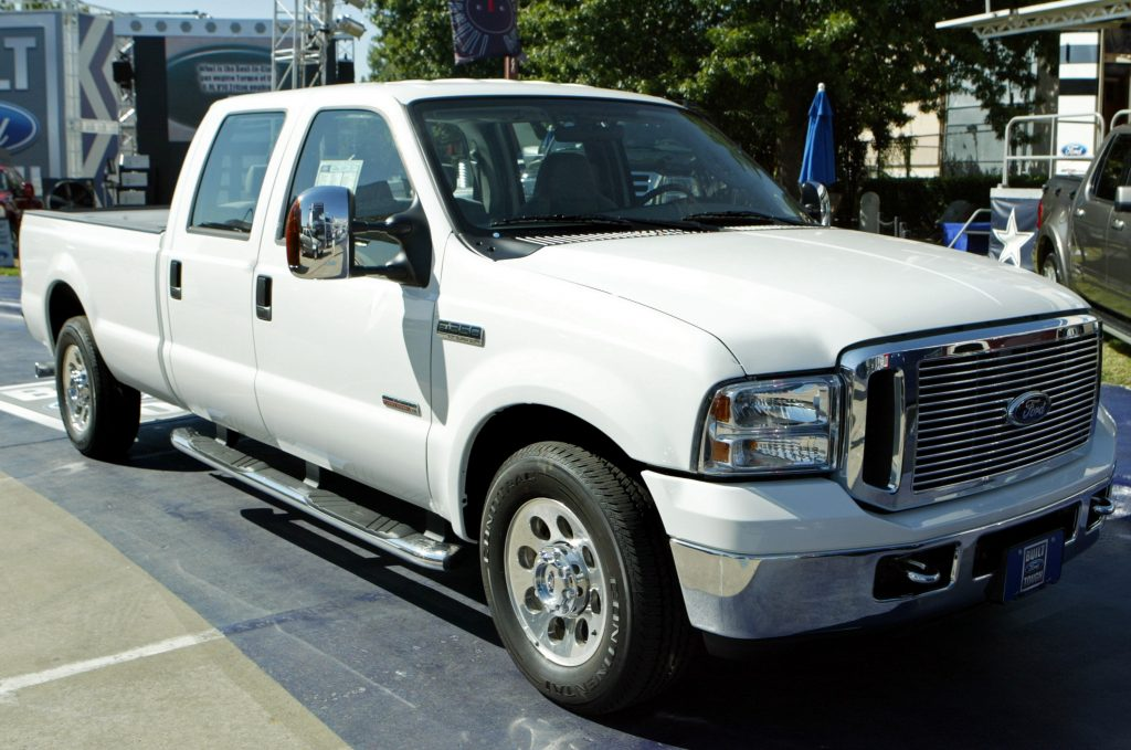 A white Ford F-350 pickup truck parked on a street