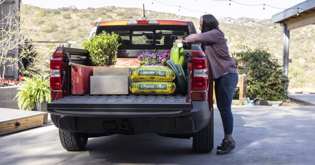 loading the Ford Maverick pickup bed full of landscaping supplies