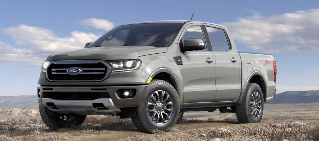 The grey 2021 Ford Ranger pickup truck sitting in a field