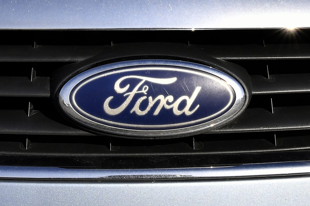 A blue oval Ford logo on a vehicle grille