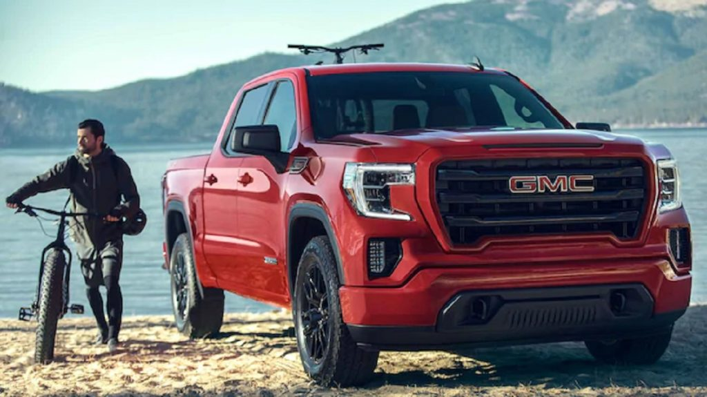 A red 2021 GMC Sierra  parked in the mountains