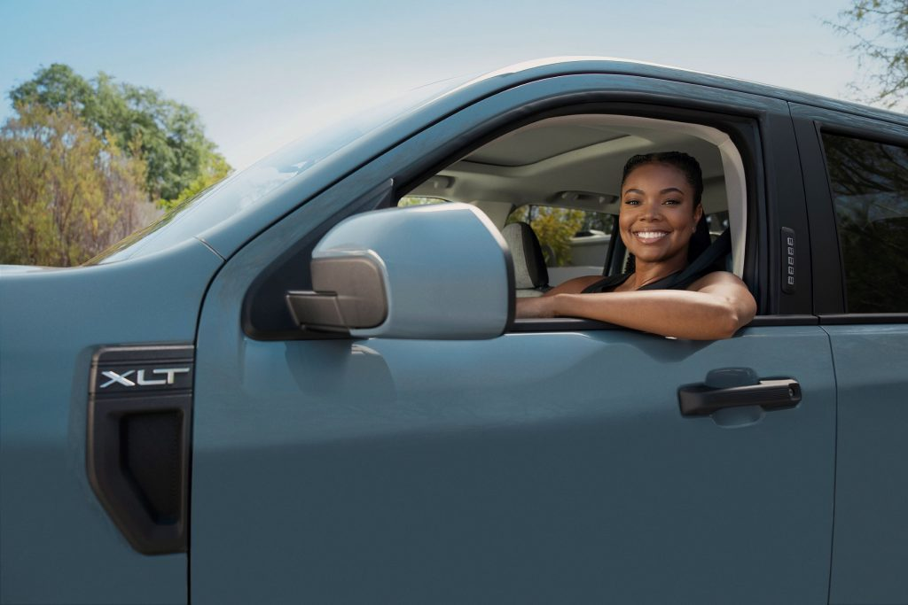 Gabrielle Union behind the wheel of a blue pre-production 2022 Ford Maverick