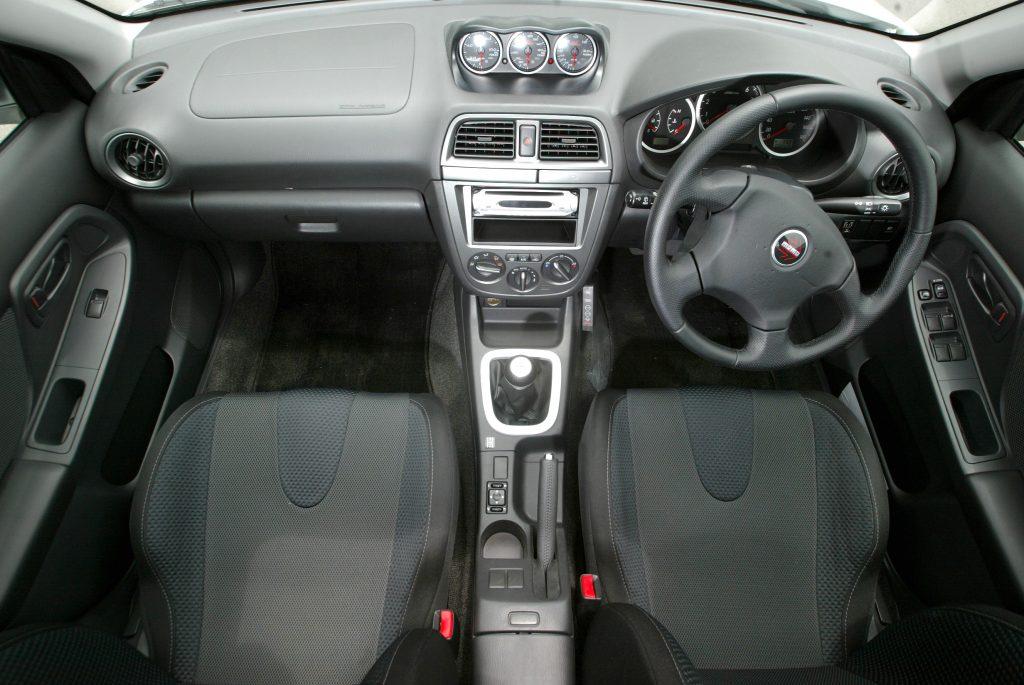 The interior of the Subaru WRX with a MOMO wheel